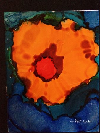 orange flower on water, alcohol ink