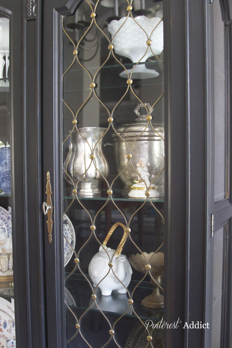 Black china cabinet with wire mesh