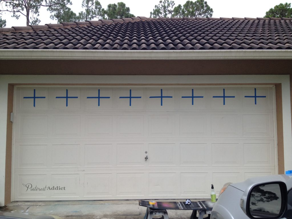 "Faux Carriage Garage Door - faux carriage garage door - Taped off the center lines with 1"" tape"