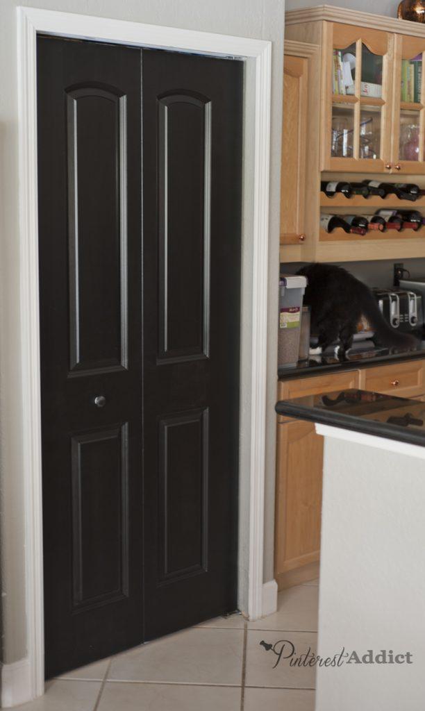 Kitchen pantry painted interior black door