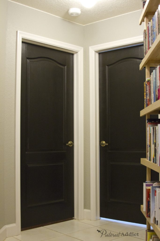 The interior doors in the hallway were painted black - LOVE how they turned  out!