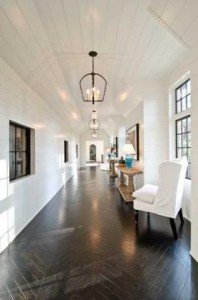 Dark wood floors, white walls