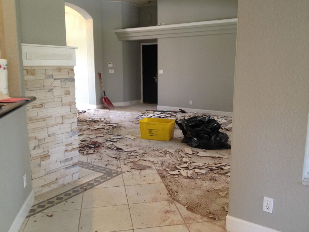 removing ceramic floor tile with chipper