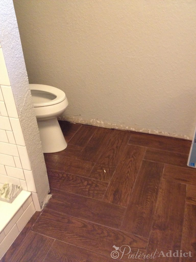 wood look tile floors - herringbone pattern wood tiles in the bathroom