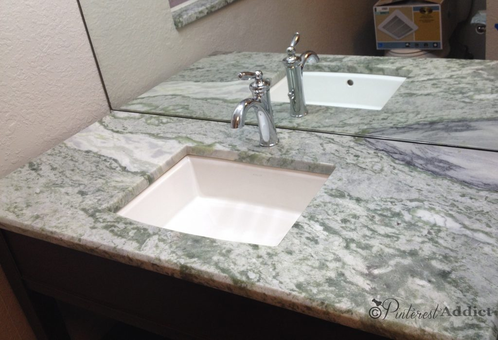 Guest bathroom makeover - Onyx counter, Moen faucet, Kohler sink