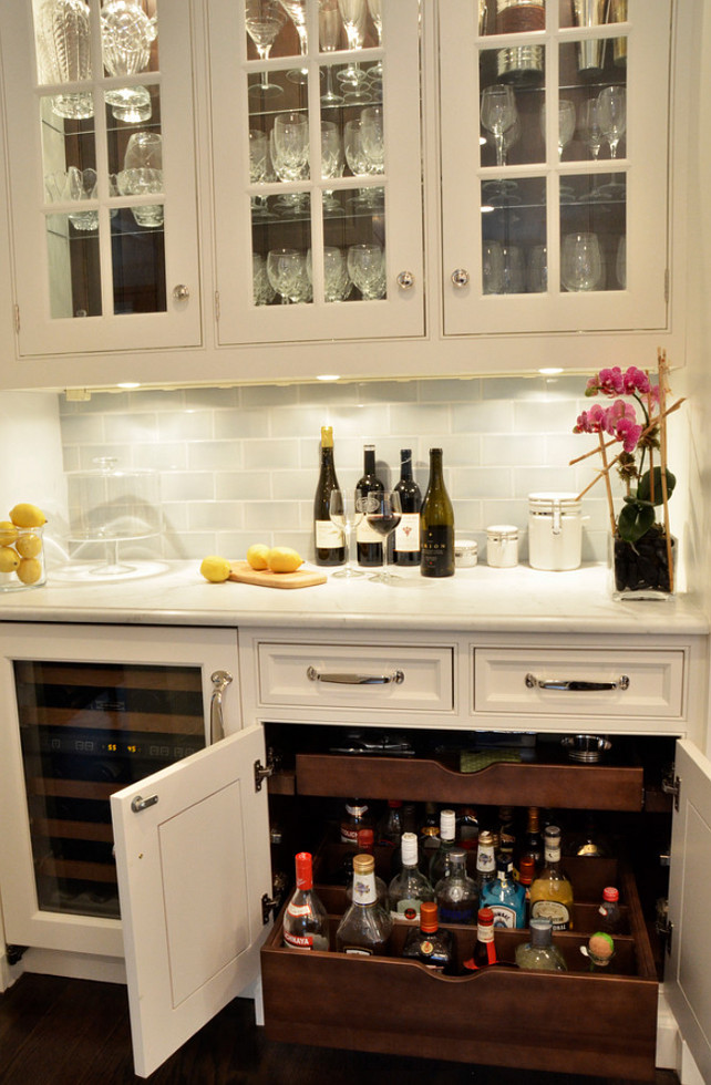 Bar-Ideas.-Bar-Cabinet-Design.-Custom-pullouts-were-designed-to-hold-liquor-bottles-upright-with-adjustable-dividers-to-keep-them-from-tipping.-Bar-
