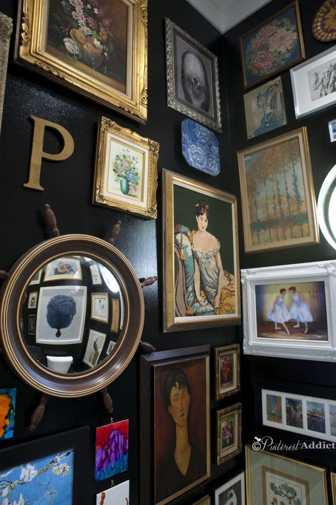Bold, black bathroom with art gallery