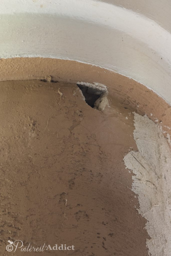 Woodpecker damage to stucco columns - How to get rid of Woodpeckers