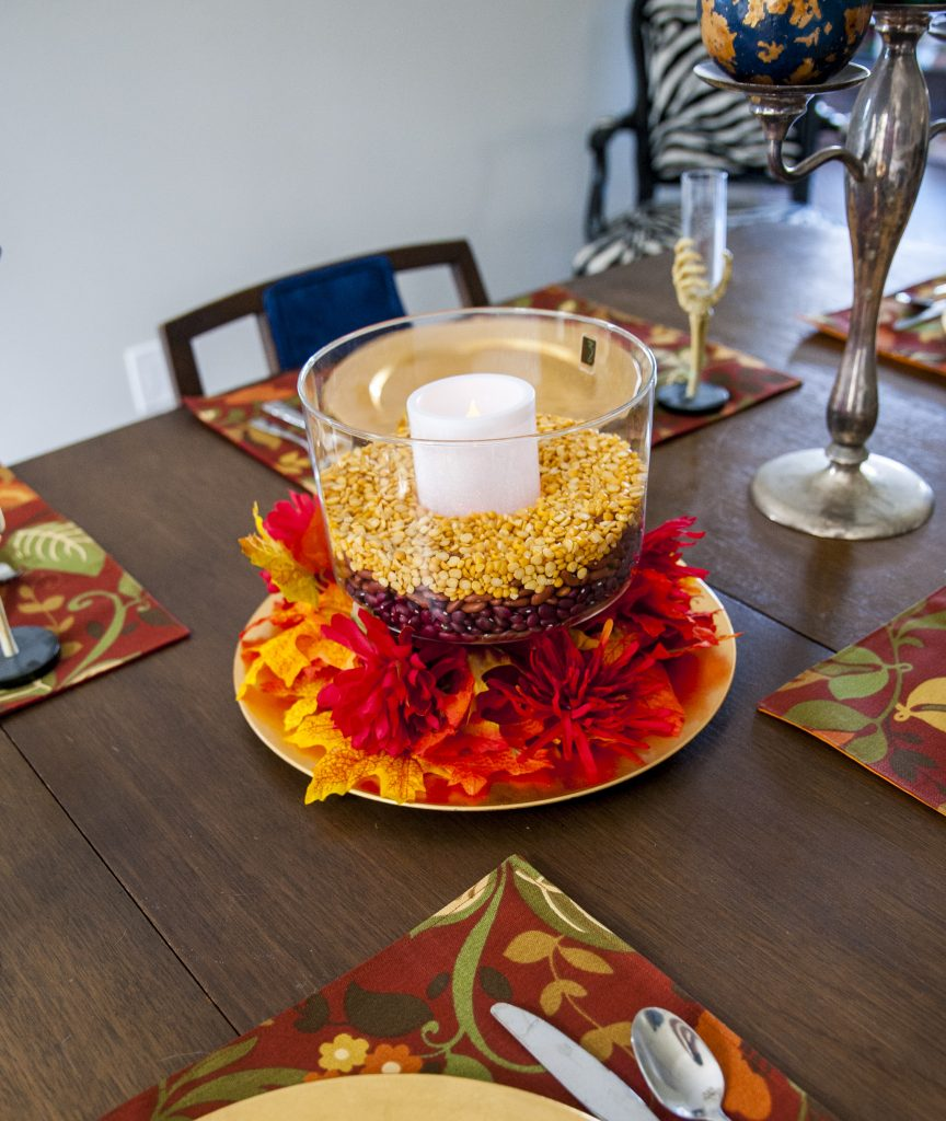 Dried beans, fall leaves and candles make for a pretty fall table centerpiece