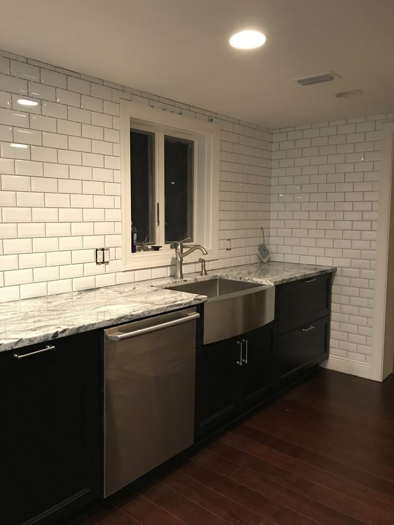 Kitchen Reveal - D. Lawless Caspian pulls - Ikea cabinets - granite counters - beveled backsplash - Check out the details on Pinterest Addict Blog