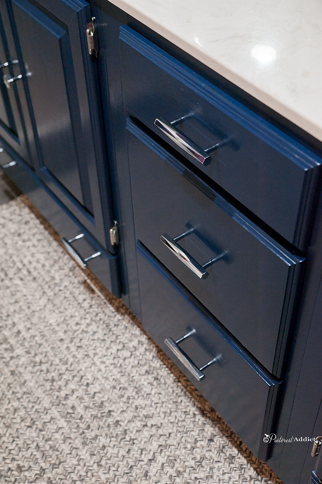 Liberty Hardware Modern drawer pulls and handles, on vanity painted Naval by Sherwin Williams