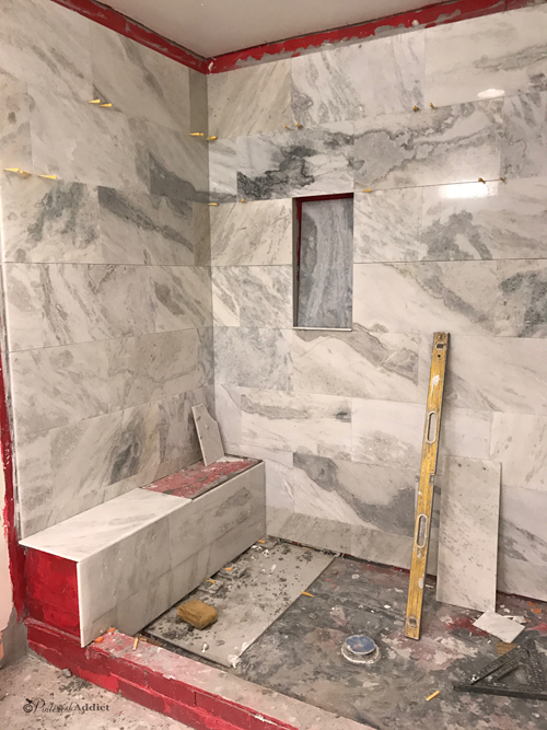 marble shower install during - Primp and Pamper bathroom refresh