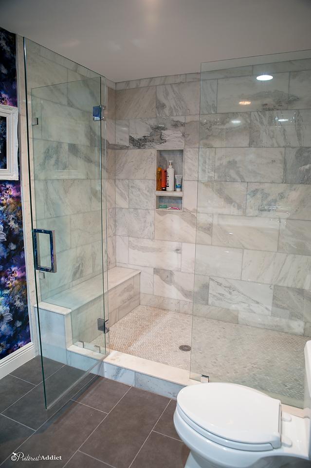 walk in shower marble, herringbone tile, bench seat