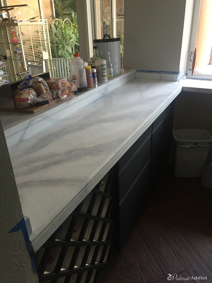 finished faux marble counter in wine bar area